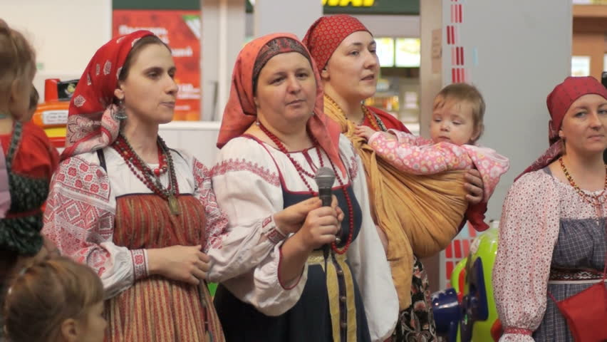 tver russia children playing on the parade of tver russia 16 2014 women in traditional russian costumes sing in