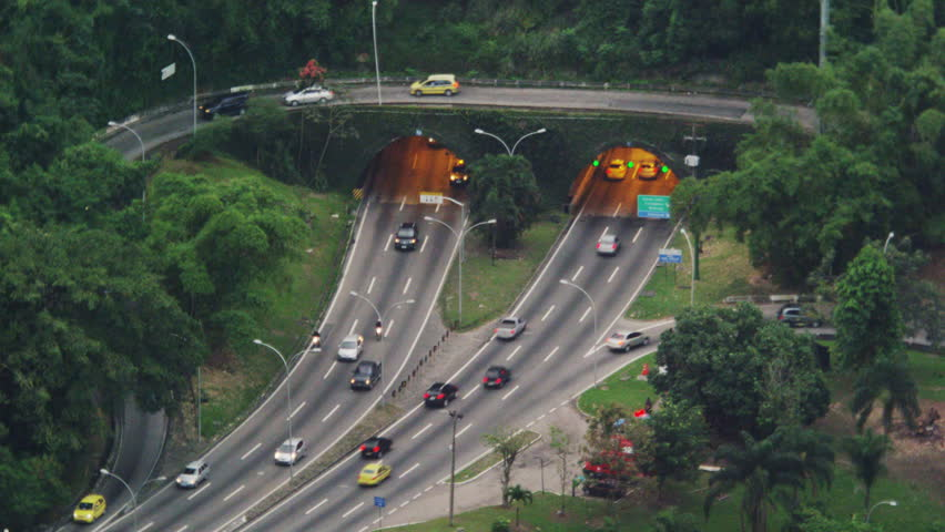 Morning still shot of the fast traffic at a tunneled intersection in Rio de