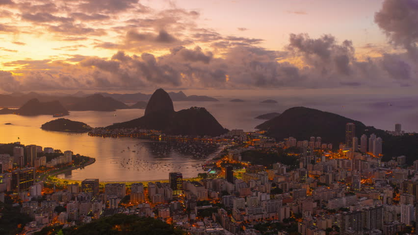 Sunrise time-lapse overlooking Rio de Janeiro and Sugarloaf Mountain. - 4K stock video clip
