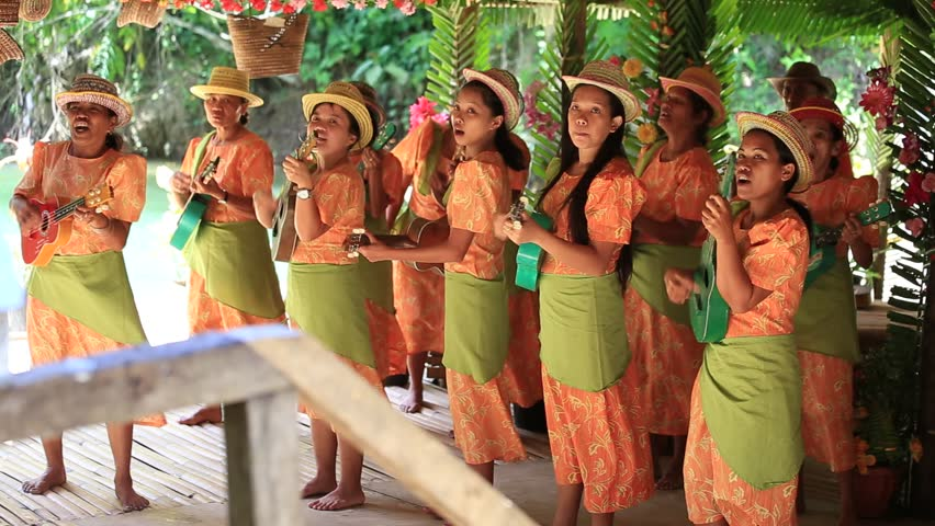 BOHOL, PHILIPPINES - FEBRUARY 21, 2014 : Unidentified folk music band performs in traditional Philippine background for tourists