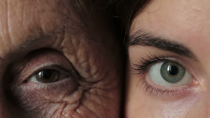 old and young eye - Grandmother and granddaughter looking together at camera