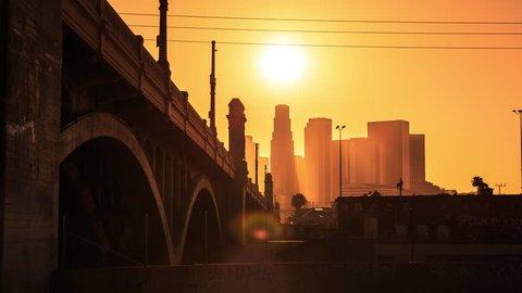 4K. Los Angeles city. Sunset sun setting into downtown LA skyline. Timelapse in motion (hyperlapse).