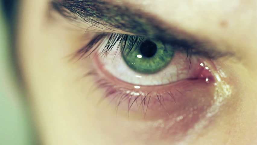 Detailed image of man's green eye with tears - cry