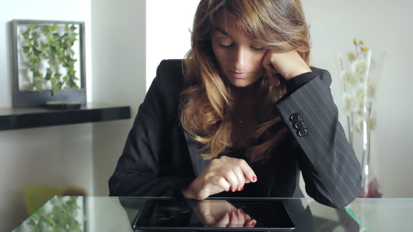 Businesswoman having difficult computer project while working in her office | Shutterstock HD Video #6195056