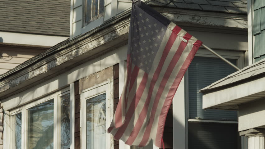 Medium Shot American flag in front of house / Queens, New York City, New York, USA