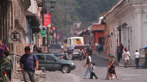 ANTIGUA GUATEMALA,GUATEMALA, MARCH 2012:Walking people.Colonial town in Guatemala-Chichicastenango.Atmosphere of the old colonial city. People, cars, motorcyclists