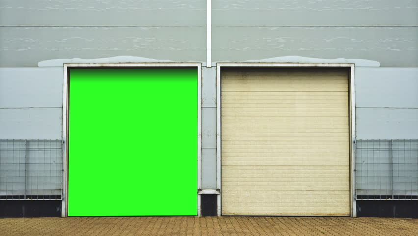 industrial unit with roller shutter doors warehouse storage doors with green screen mate background are