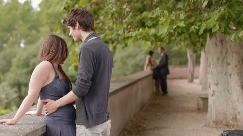 Boy Kissing Beautiful Girl , There Is A Mature Couple In
