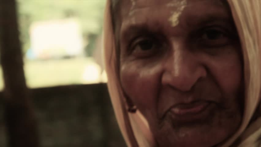 A sweet old Indian village lady gives a subtle, wise smile for the viewer.  Filmed in Navadvipa, Bengal, India in 2014. HD 1920 by 1080. Close up. Still shot. | Shutterstock HD Video #6227006