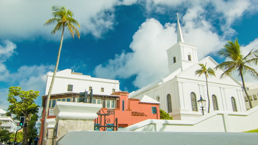 Panning Towards The Wesley Methodist Church in Hamilton, on a Sunny Day in Bermuda with Green Trees and White Clouds in a Blue Sky.