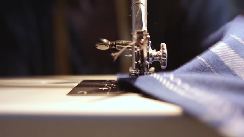 sewing machine - seamstress - sew a dress in a textile factory