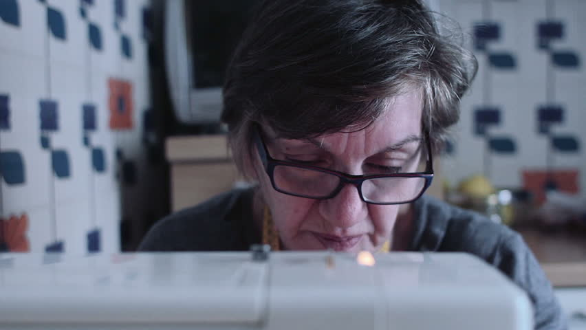 Portrait of a seamstress is working with sewing machine - dress | Shutterstock HD Video #6233756