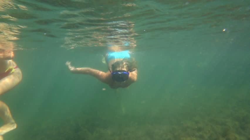Teenage girl is diving underwater in mask.   Shutterstock HD Video #6240806