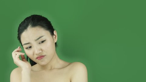 Asian girl naked beauty young adult isolated greenscreen green background thinking scratching head