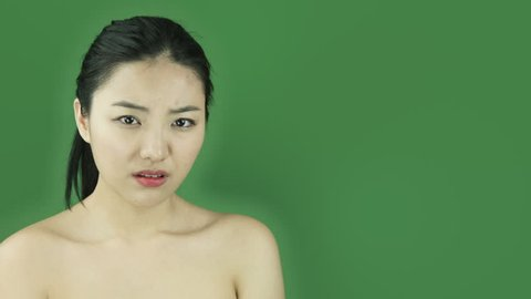 Asian girl naked beauty young adult isolated greenscreen green background worried