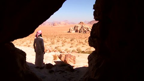 WADI RUM, JORDAN CIRCA 2013 - A Bedouin man looks out across the desert.
