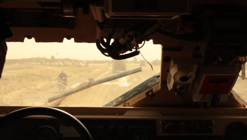 pov from MRAP driver following in convoy in middle east
