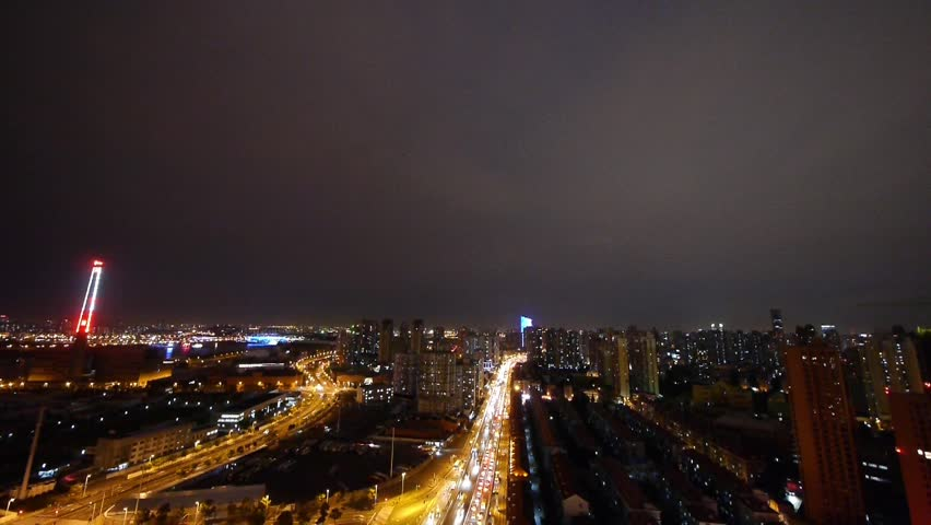 Freeway busy city rush hour heavy traffic jam highway Shanghai at night,two parallel roads,Brightly lit urban morden building background. gh2_07208 | Shutterstock HD Video #6282836
