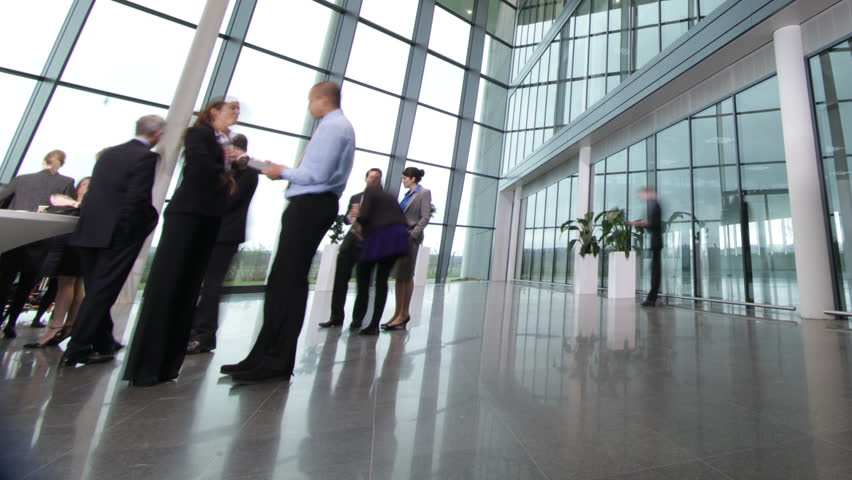 Time lapse of diverse business group in a large modern corporate building | Shutterstock HD Video #6283526