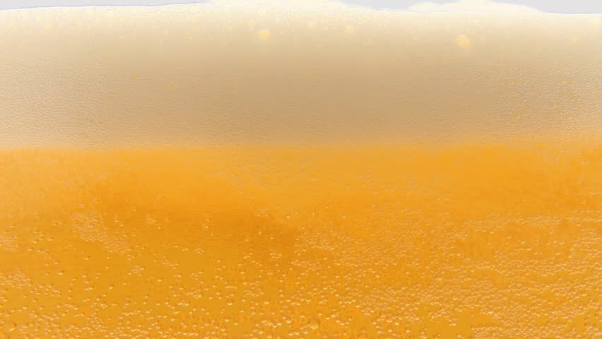 Pouring cold beer into glass