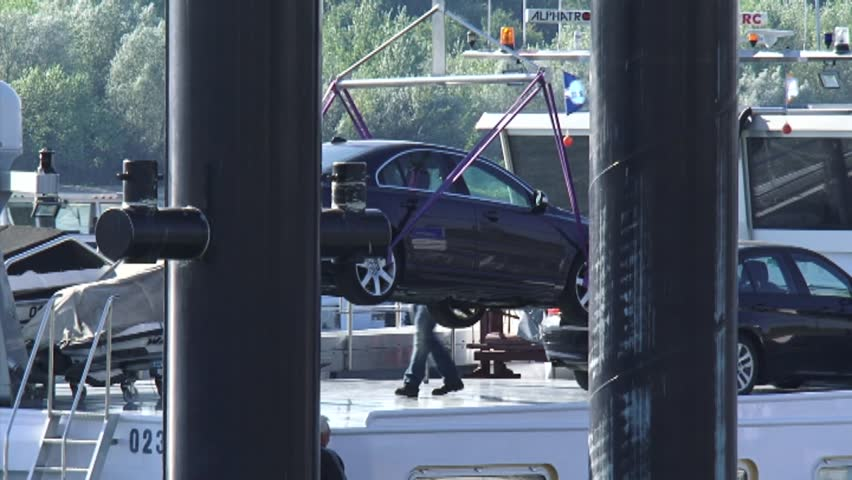 TOLKAMER, THE NETHERLANDS 29 SEPTEMBER 2013: Hoisting up a car from a ship to a pier - close up   Shutterstock HD Video #6324908