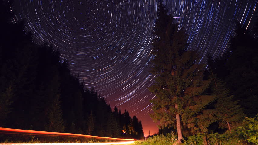Star trails in the mountains forest road - moving stars star trails timelapse