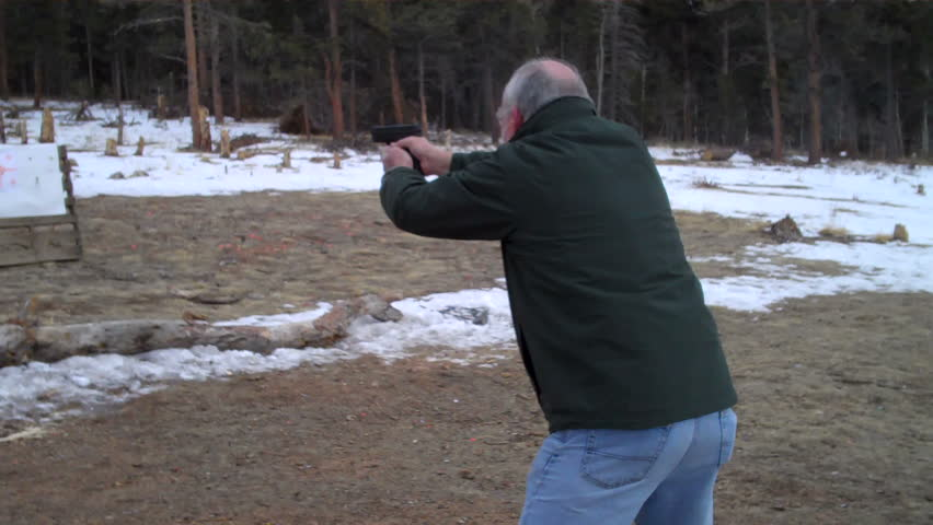 senior citizen practicing firearm self-defense on the range
