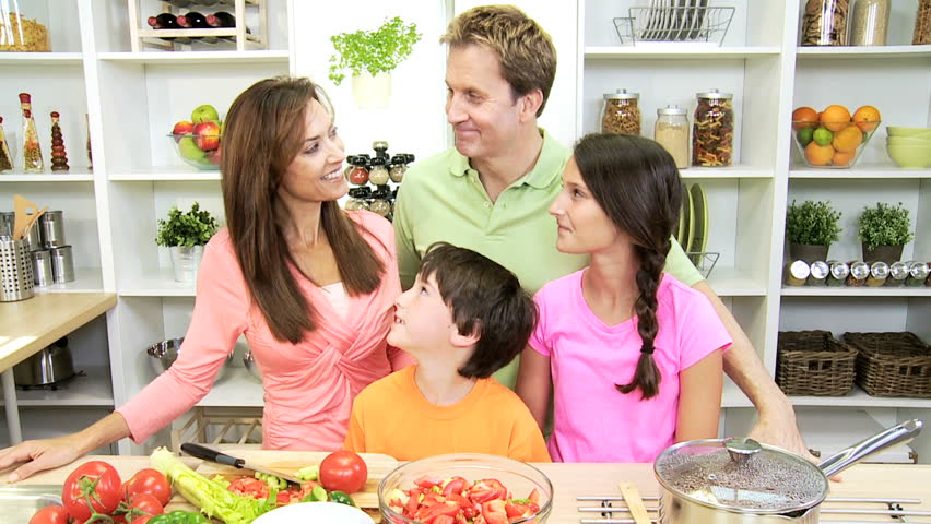 Happy Young Family Cooking In Kitchen At Home, Vegetables ...