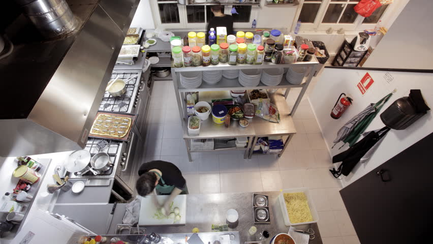 Busy Restaurant Kitchen timelapse shot looking down on two chefs preparing food in a busy