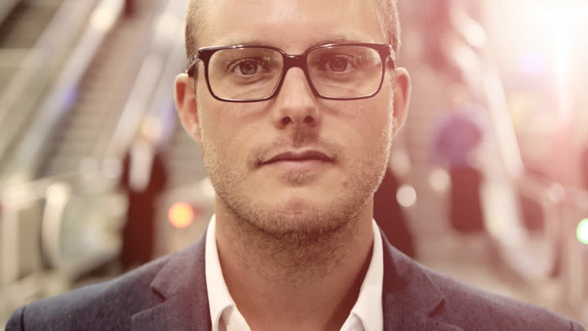 Young caucasian man putting glasses on. handsome attractive. businessman. person people. crowd. busy. city urban. lifestyle. facing camera. commuting background | Shutterstock HD Video #6357686