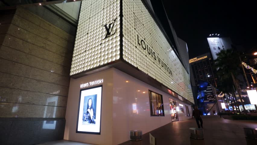 KUALA LUMPUR, MALAYSIA - CIRCA FEB 2014: Louis Vuitton store. Forbes says that Louis Vouitton was the most powerful luxury brand in the world in 2008 with $19.4bn USD value.  | Shutterstock HD Video #6480326