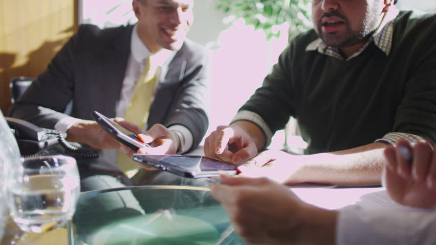 Office workers discuss plans | Shutterstock HD Video #6496136