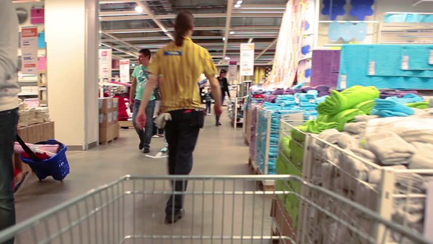 SAINT-PETERSBURG, RUSSIA-CIRCA MAY, 2014: Timelapse of shopping cart drives through the showroom of Ikea. Russian Ikea store and services