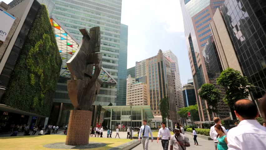 SINGAPORE - CIRCA FEB 2014: People at Raffles Place. Several key buildings are located in Raffles Place, including UOB Plaza, One Raffles Place, Republic Plaza, One Raffles Quay and OCBC Centre.