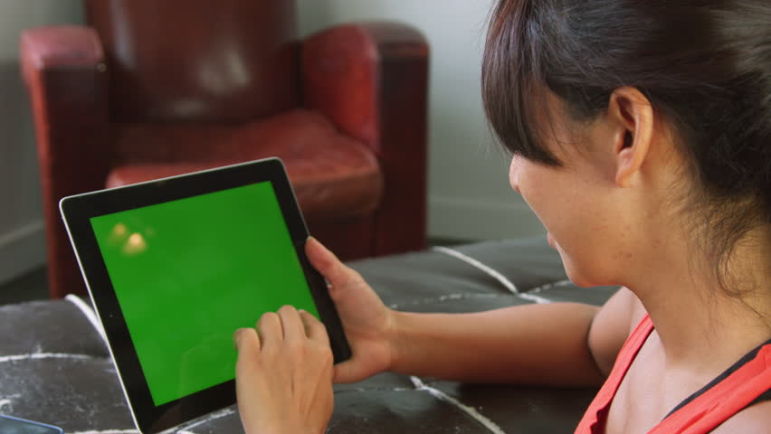 arabic woman using touch screen tablet in living room #6547106