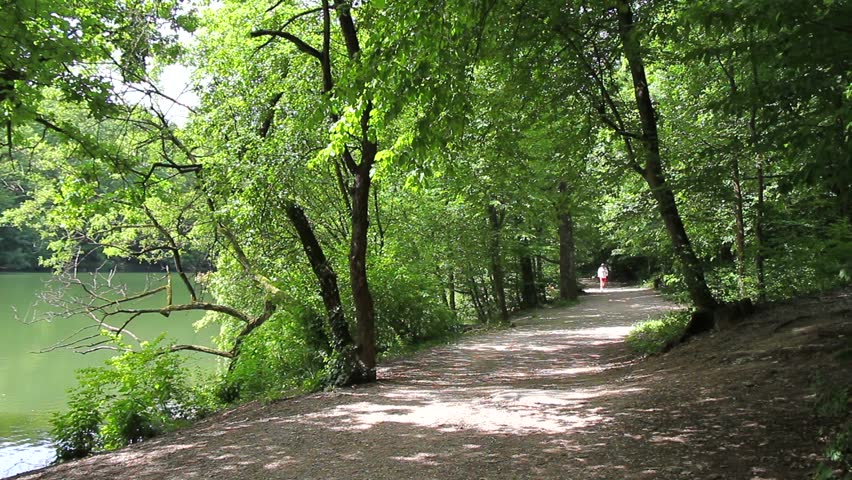Maksimir Park, Zagreb, Croatia.  Spring 2014: man jogs in One of the oldest and most beautiful public parks in Europe.