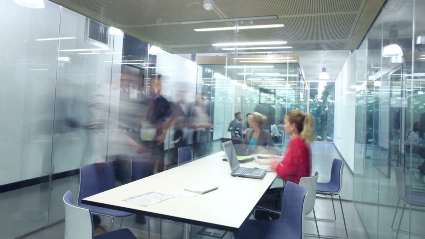 Time lapse of young attractive business group in a meeting in modern city office