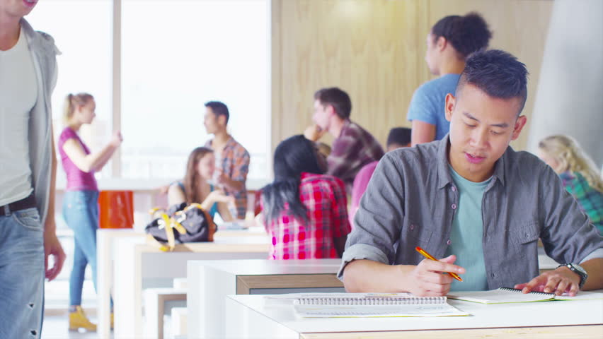 Happy student group working and relaxing together in cafe area of college | Shutterstock HD Video #6557261
