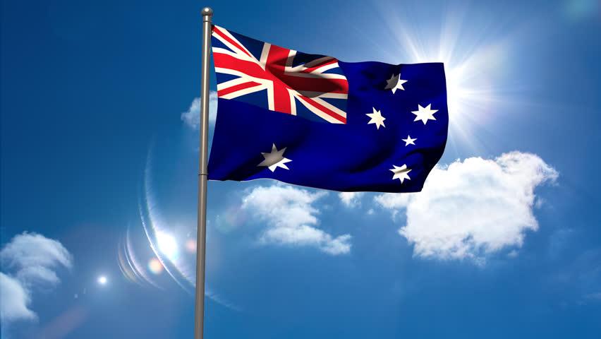 Australia national flag waving on flagpole on blue sky background - HD stock video clip