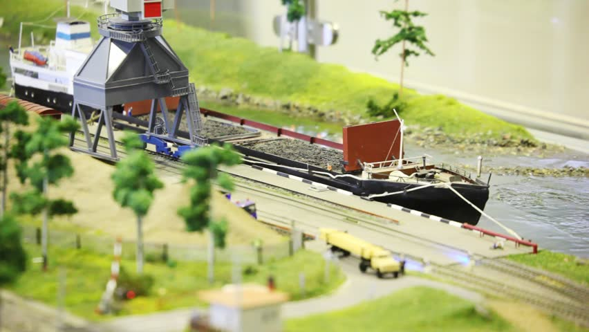 Toy Train Bring Empty Cargo Wagon On Rail To Storage Station In Port Near  Transport Ship Stock Footage Video 657769 | Shutterstock