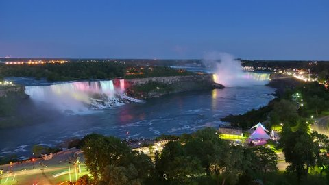 A time lapse day to night shot of Niagara Falls.