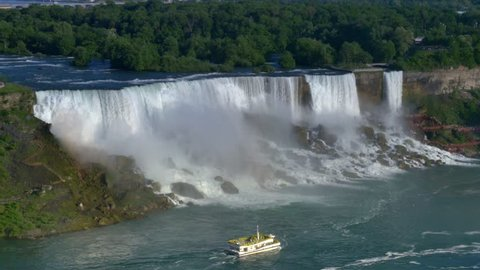 An establishing shot of Niagara Falls on a summer day.