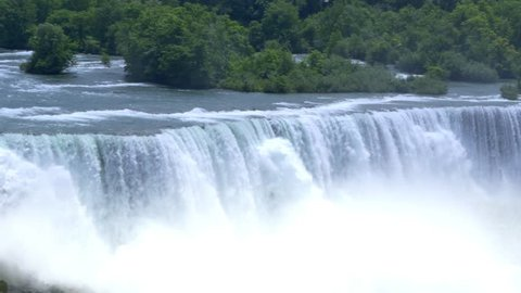 An establishing shot of the American Falls on a summer day.