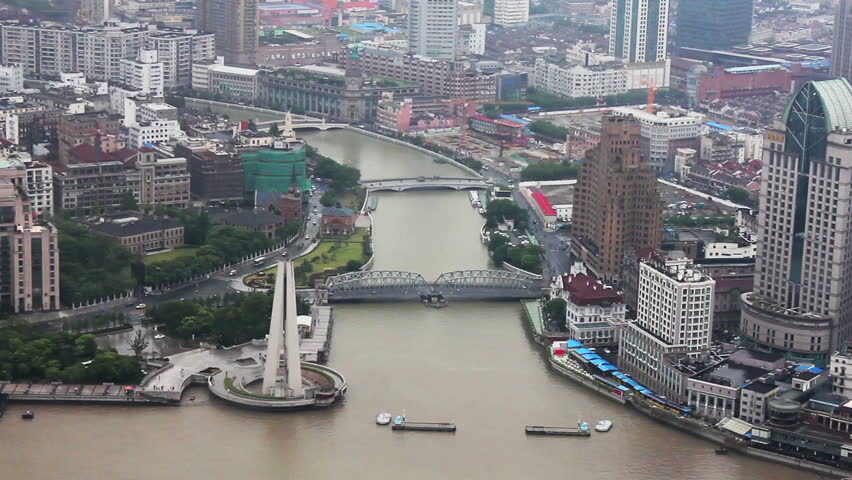 View of shanghai city with several bridges spreading over a river , Shanghai, China