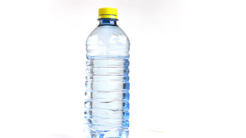 Close up of rotating bottle of water isolated on a white background, loopable - 1080p