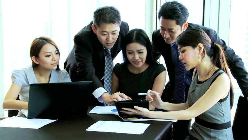 Asian Chinese successful business team conference together modern city boardroom discussing latest financial results seen laptop computer touch screen tablet technology | Shutterstock HD Video #6643721