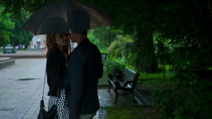 Couple in love kissing under the rain. RAW video record. | Shutterstock HD Video #6679166