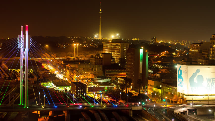 Johannesburg, Gauteng, South Africa - 25/07/2013.  A colourful display of nighttime traffic crossing the Nelson Mandela Bridge in the city centre of Johannesburg.