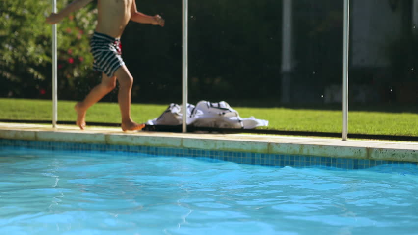 Sportive Boy Jumping Inside The Pool Child Sprinting To Jump