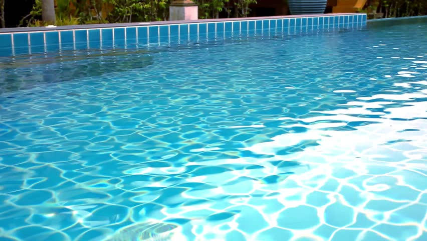 stock video of clear blue swimming pool close up